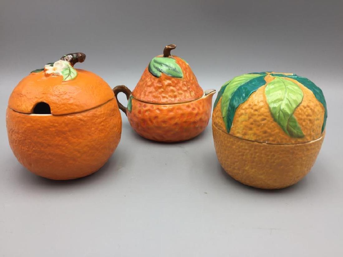 3 Orange porcelain serving pieces
