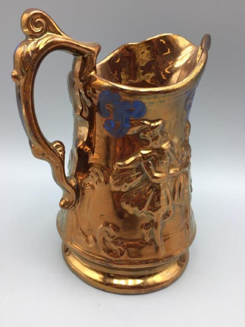 5 Copper Luster pitchers - 5