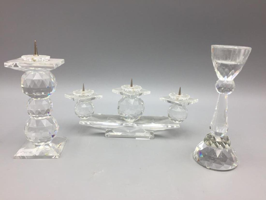 Lot of three Swarovski candlesticks