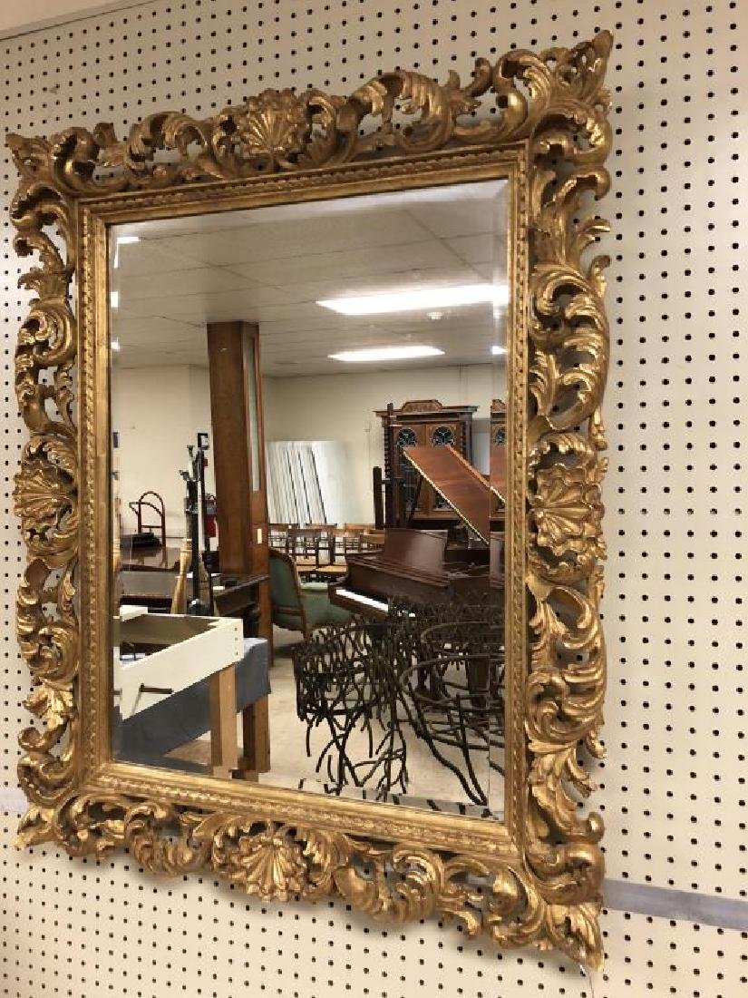 Ornate carved gilt wall mirror