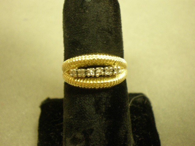 118: Diamond band. 14K yg (tested) with center in-line