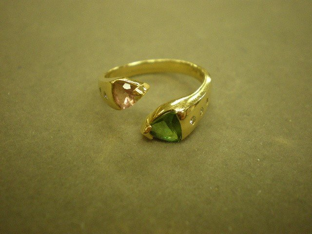 "120: Tourmaline ring. 14K yg (marked), ""B&H"", open ring"