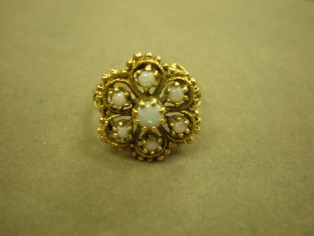 121: Opal cluster ring. 14K yg (marked) with center sev