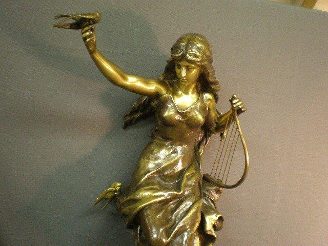 """84: Bronze female figural statuette. Signed """"Math.Thore"""