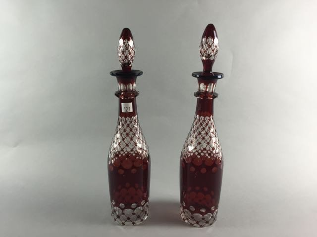 Pair of cranberry cut to clear decanters