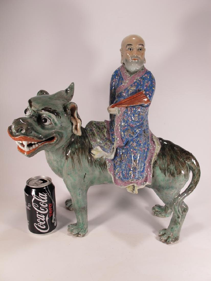 Antique Chinese ceramic mounted on foodog statue