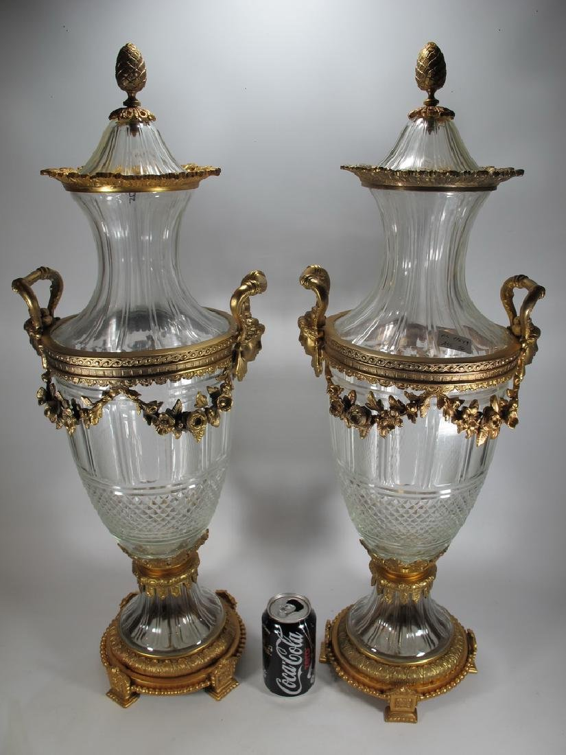 Marked Baccarat pair of bronze & glass urns