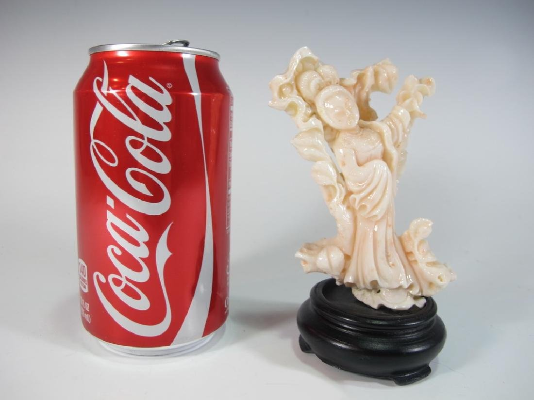 Antique Chinese carved coral statue