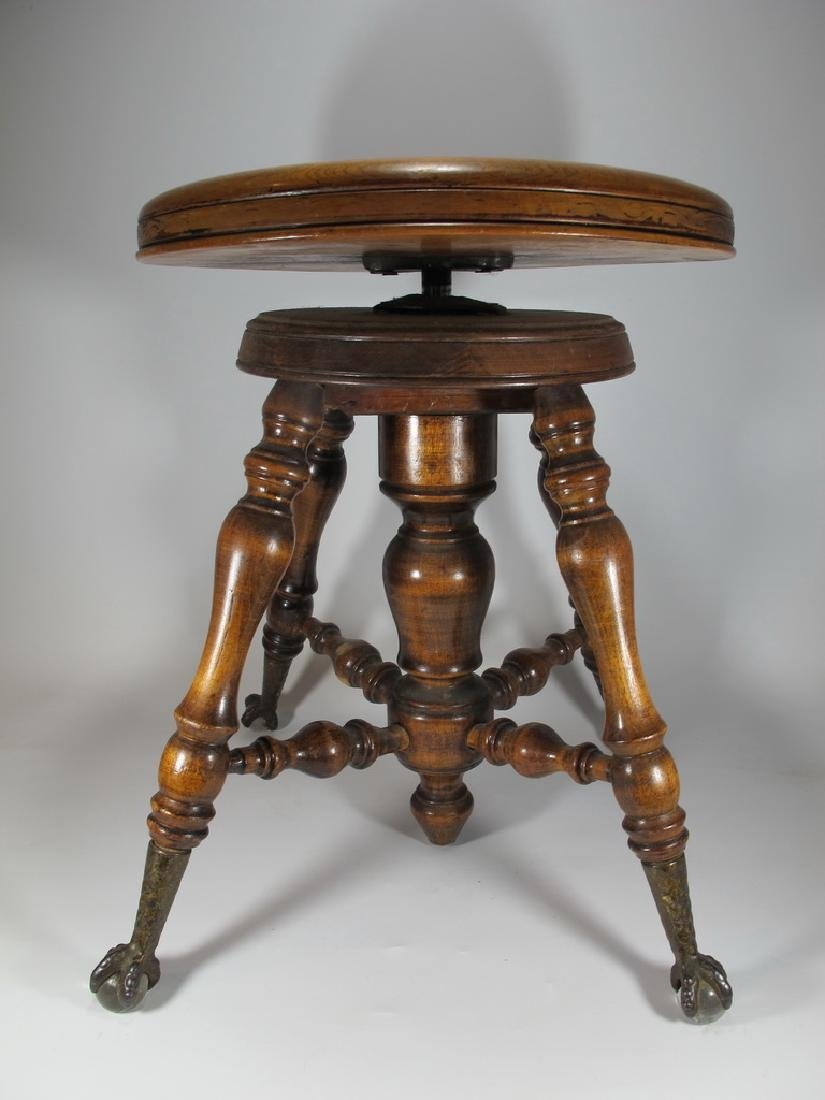 Antique European piano stool with glass feet