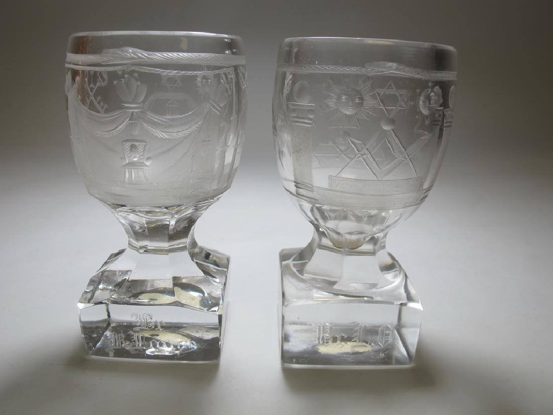 Lot of two Masonic firing glass goblets