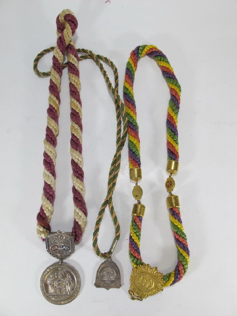 Lot of three Masonic cordon collars with medals