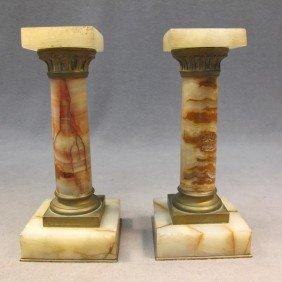 20: Pair of miniature onyx pedestals