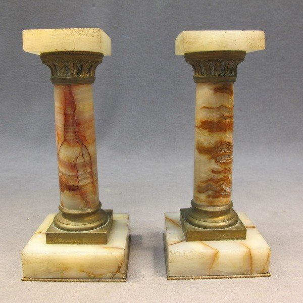 20: Pair of miniature onyx pedestals