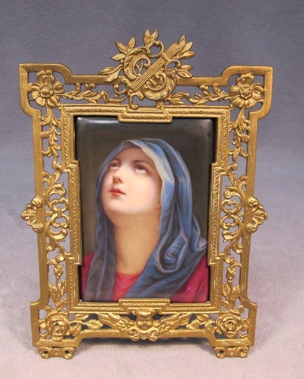 66: Religious bronze & porcelain plaque