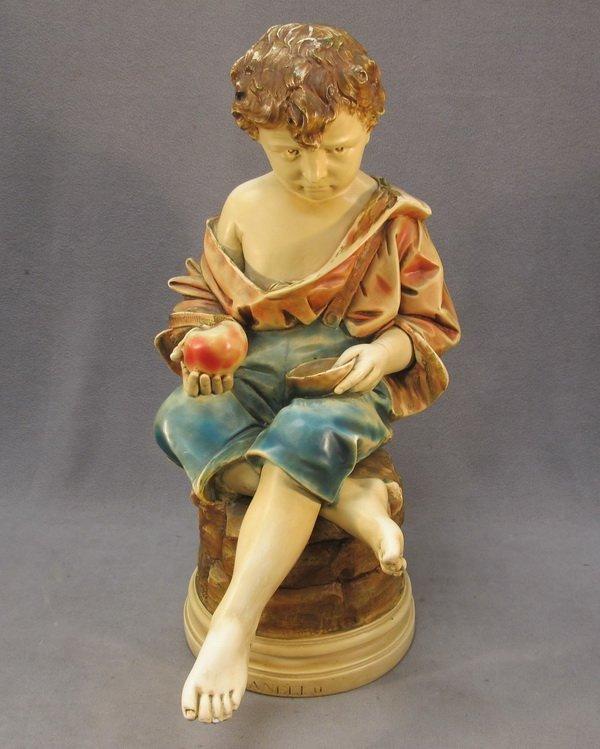 10: Old plaster boy sculpture