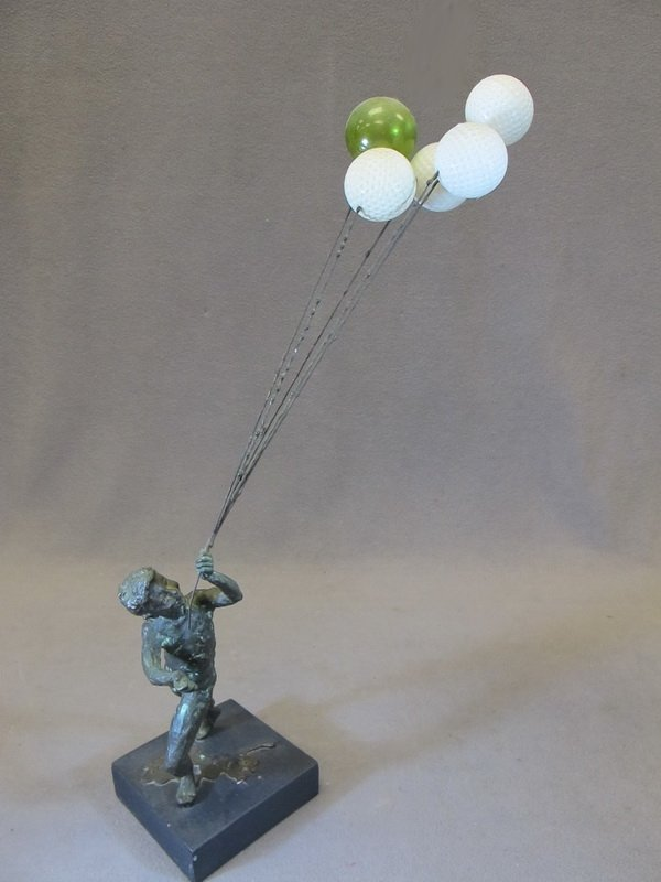 22: Child with balloons bronze statue