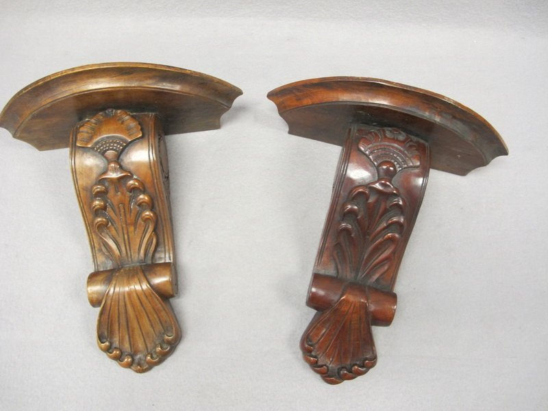 Two old simillar carved wood brackets
