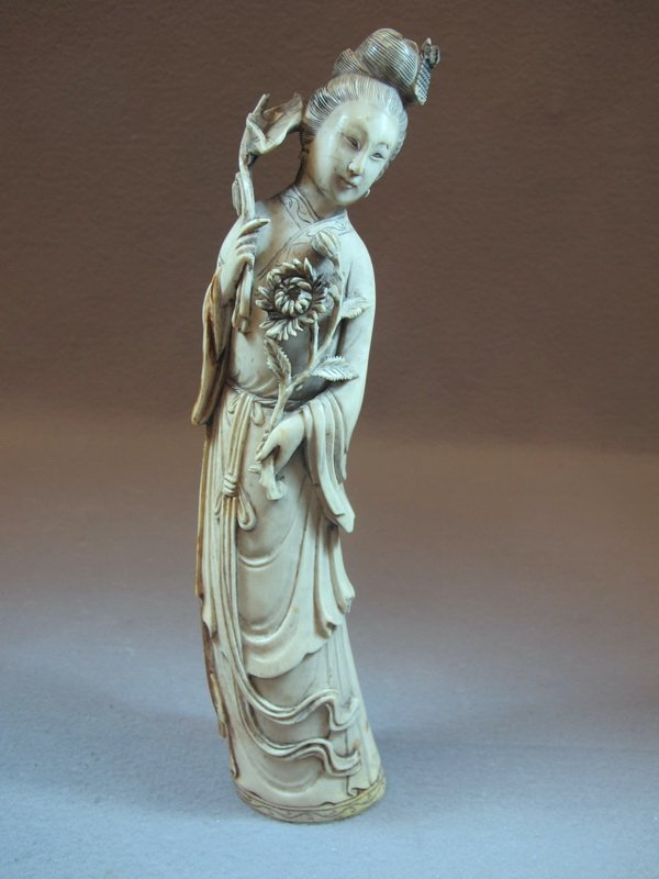 Antique Chinese carved ivory statue