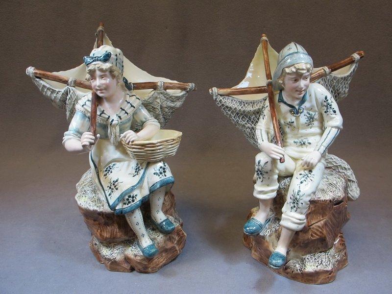 European pair of majolica statues
