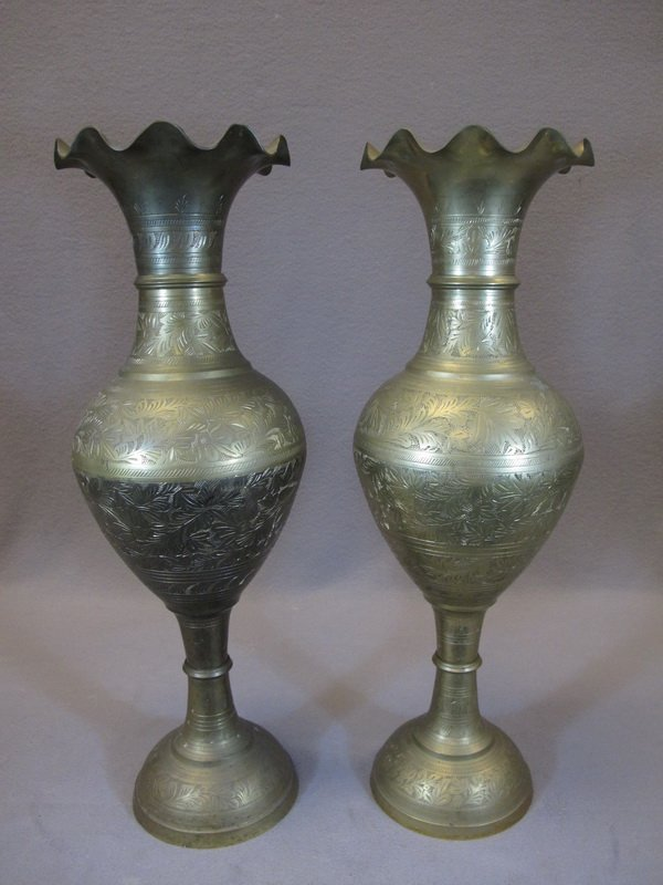 Pair of carved brass urns