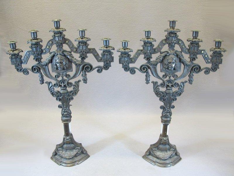 Antique pair of religious bronze candelabras