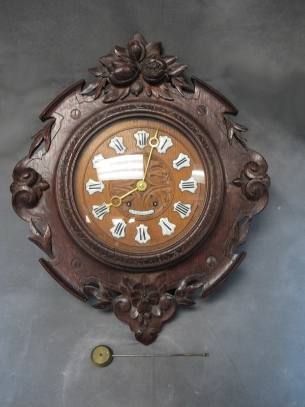 Old carved wood wall clock