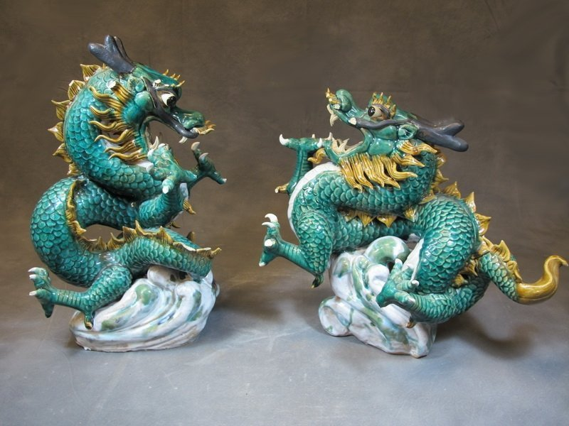 Old Chinese pair of ceramic dragon statues