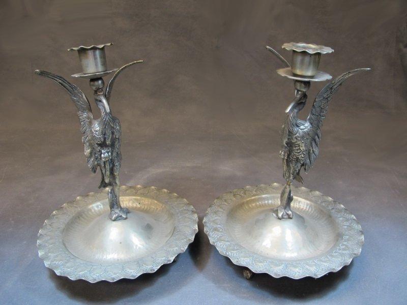 Old pair of metal candelabras