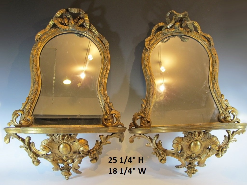 Antique pair of gilt wood mirrors with shelf