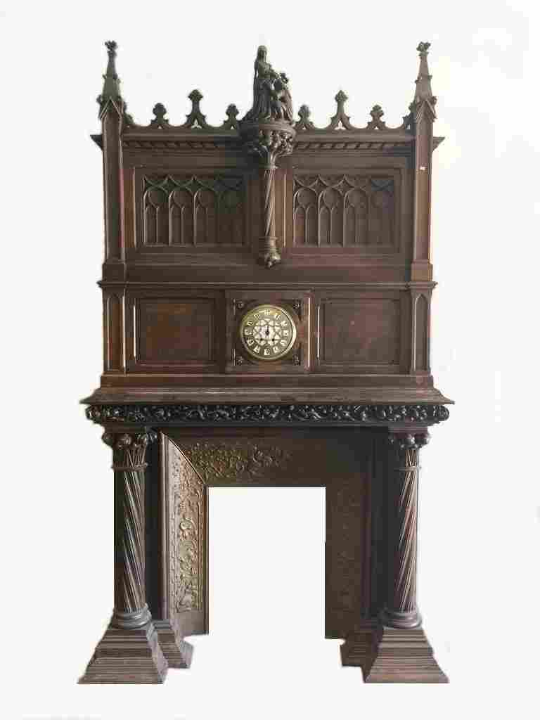 Huge 19th C European wood fireplace with a clock