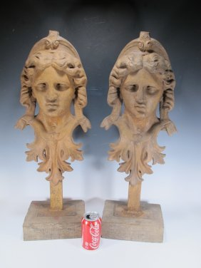 Antique Pair Of Iron Masks On A Wood Base