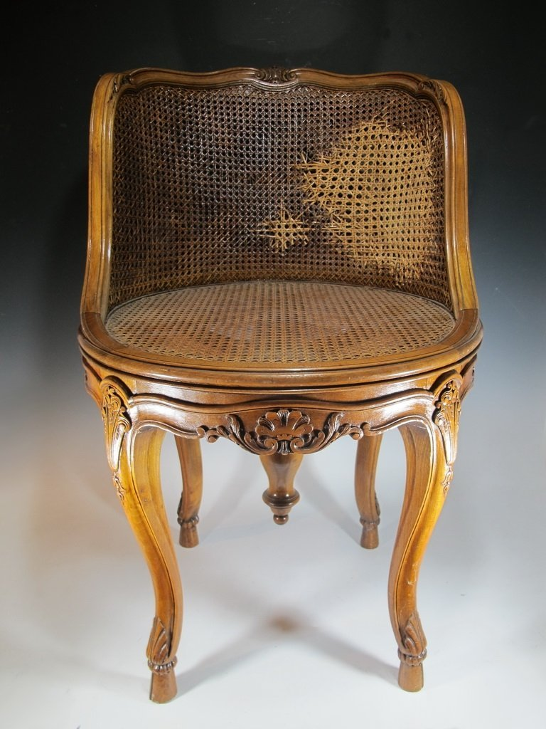 Antique French Luis XV style caned piano chair