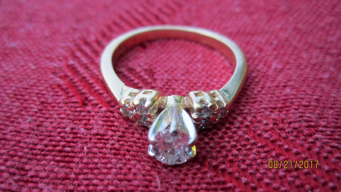 FABULOUS 14K RING WITH 50 PT. OVAL CENTER DIAMOND WITH