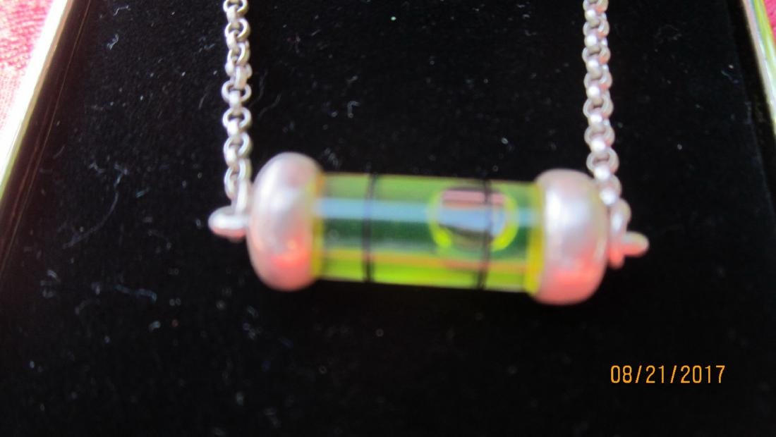 UNUSUAL STERLING NECKLACE WITH WORKING LEVEL PENDANT -