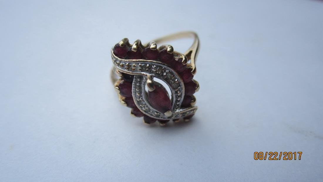 UNUSUAL 10K RING WITH MARQUISE CENTER RUBY AND 16 SIDE
