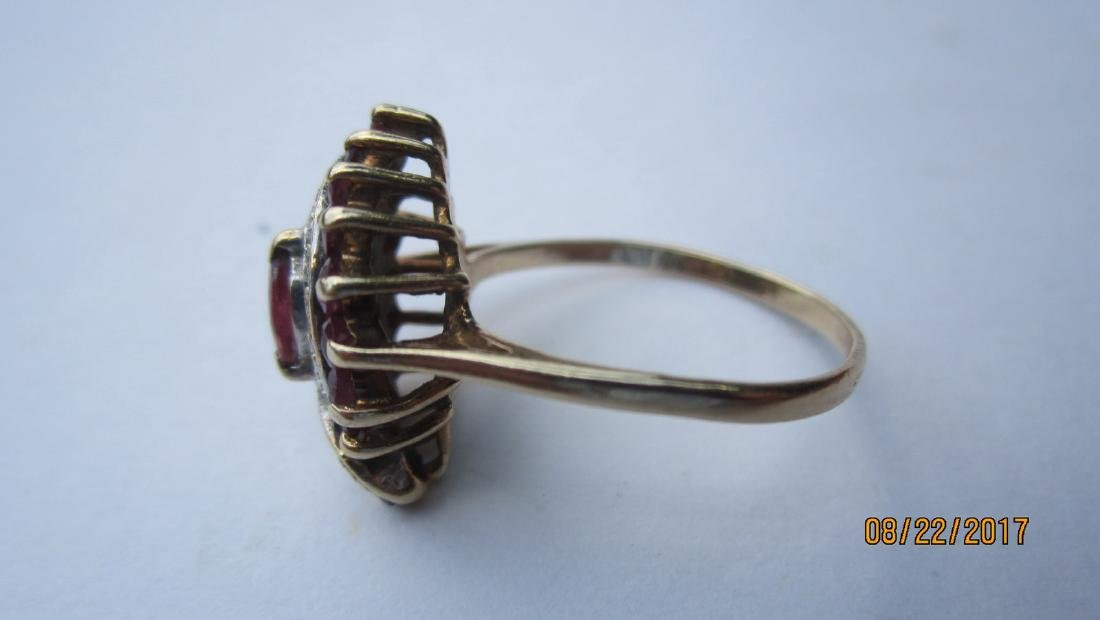 UNUSUAL 10K RING WITH MARQUISE CENTER RUBY AND 16 SIDE - 2