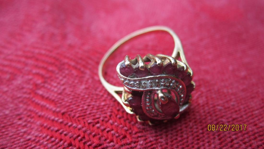 UNUSUAL 10K RING WITH MARQUISE CENTER RUBY AND 16 SIDE - 4