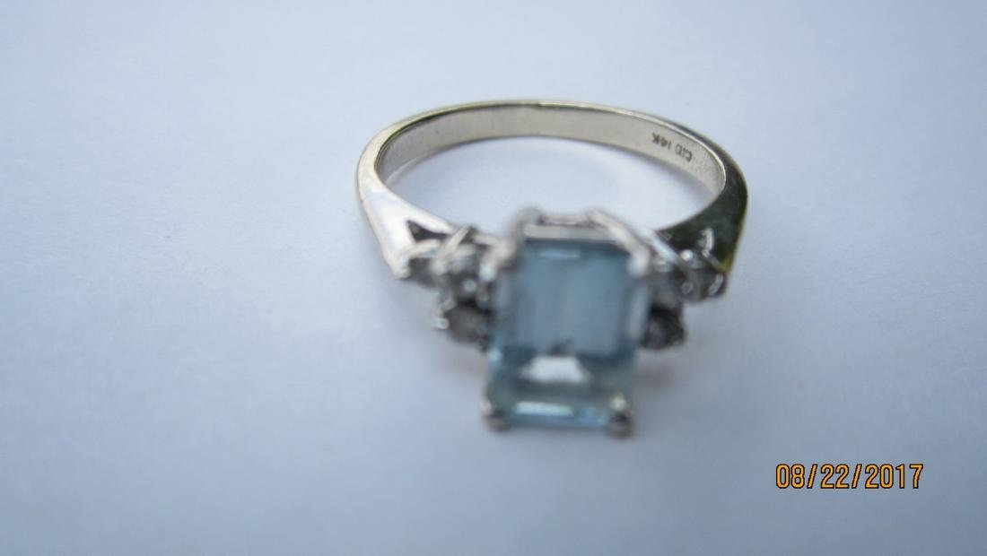 14K AQUAMARINE RING WITH 6 SMALL DIAMONDS - SIZE 5.25 -