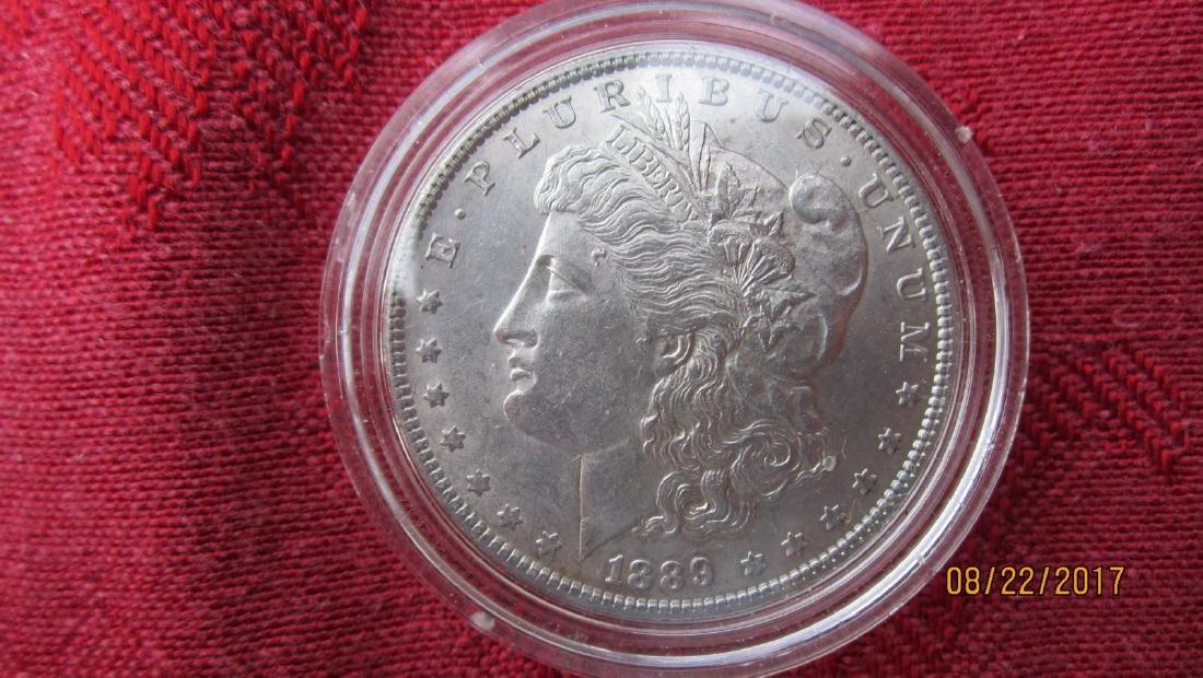 1889 MORGAN SILVER DOLLAR AU COND. IN U.S. MINT CASE