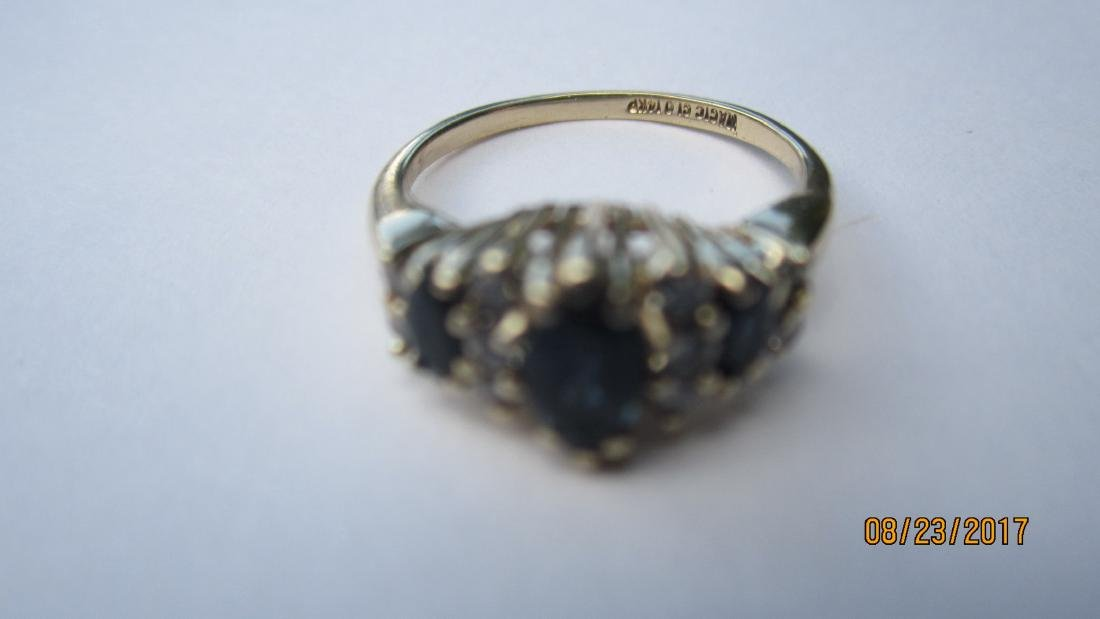 14K RING WITH 3 MARQUISE SAPPHIRES AND 10 ROUND