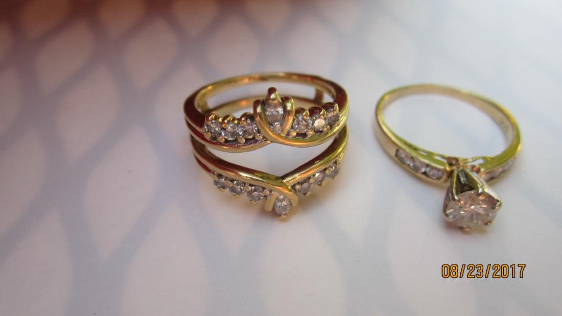 MAGNIFICENT 2 PC. RING SET WITH APPROX. 45 PT. CENTER