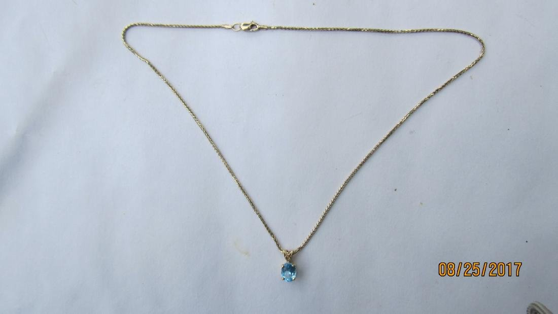14K 15 INCH NECKLACE WITH A 14K PENDANT AND A BLUE