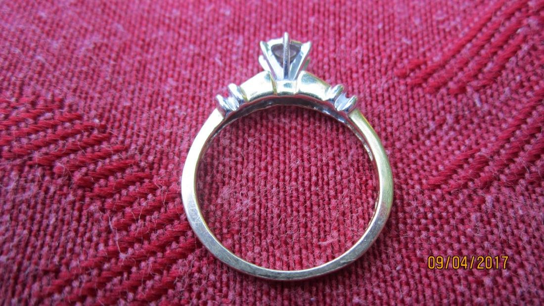 10K RING W/ APPROX. 15 PT. CENTER DIAMOND AND 4 SIDE - 3