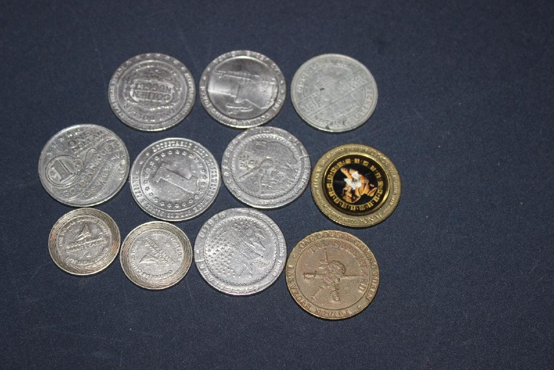 11 LAS VEGAS GAMING TOKENS - SEVERAL DIFFERENT CASINOS