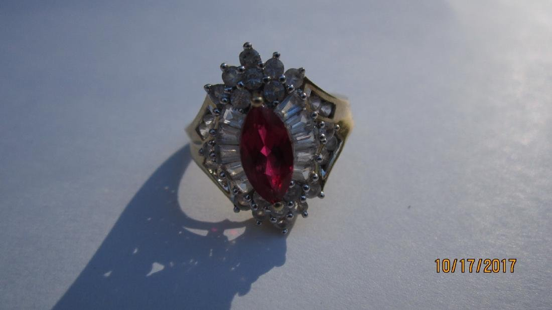 UNUSUAL 10K WITH MARQUISE SHAPE RUBY WITH BANQUETTE AND