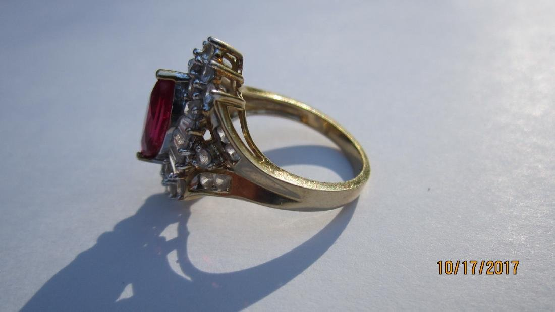 UNUSUAL 10K WITH MARQUISE SHAPE RUBY WITH BANQUETTE AND - 2
