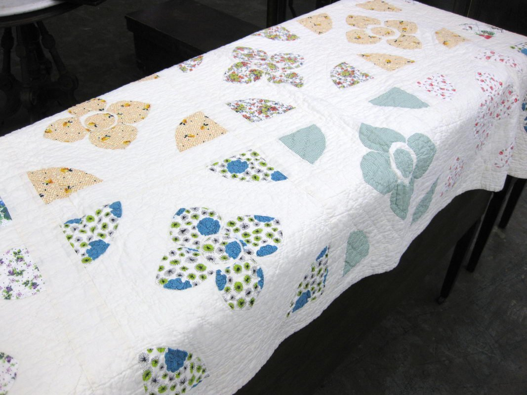 16: HAND SEWN QUILT