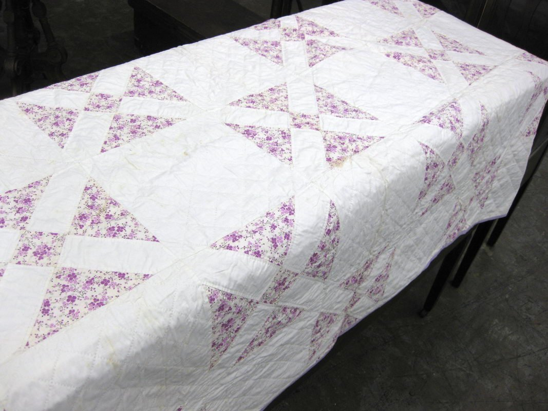 17: HAND SEWN QUILT