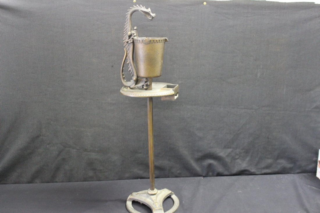 17: GREAT AND UNUSUAL IRON SMOKING STAND FINISHED IN BR