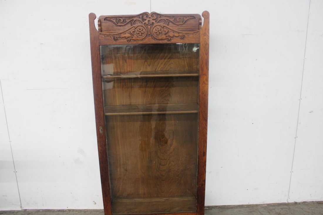 22: HEAVILY CARVED OAK FLAT FRONT CHINA WITH THREE SHEL